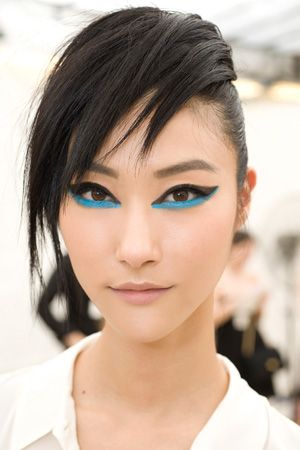 Sam McKnight's and Peter Philips's floppy hair and aqua and black cat eye makeup look at Chanel Resort 2014 | allure.com