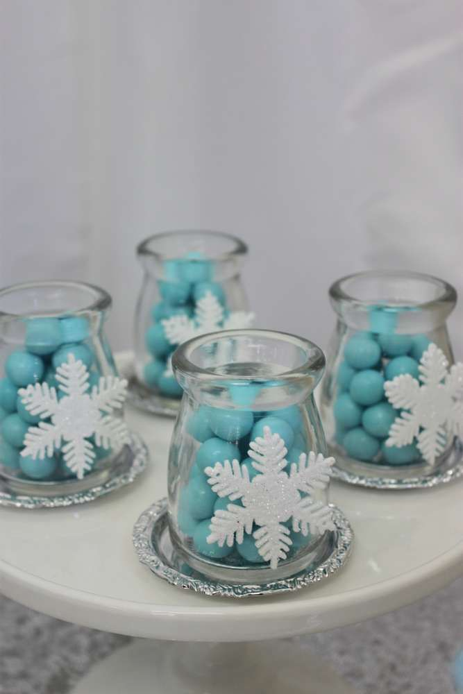 Snowflake candy jars at a Frozen birthday party! See more party planning ideas at CatchMyParty.com!