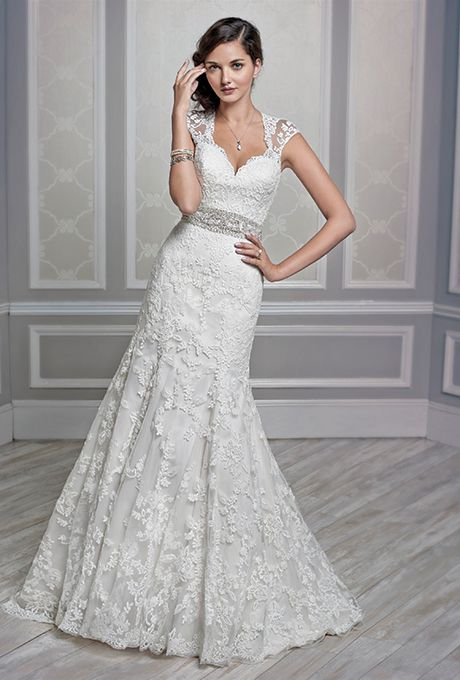 Brides.com: . Wedding dress by Kenneth Winston