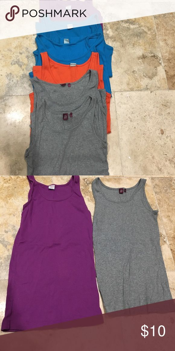 Bundle 7 boyfriend ribbed tanks 16/XL The colored tanks are by Nordstrom Ivy Moon and slightly longer. There are 2 teal blues, 1 purple, 1 orange. The gray tanks are both by Fire and Ice. These are great worn alone or for layering. All sized 16/XL girls. In great condition as most actually look like they hadn't been worn. Just found a Camo print I've added too so total 7 tanks. Shirts & Tops Tank Tops
