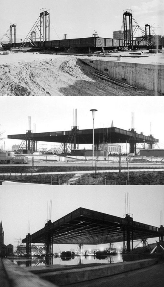 MIES VAN DER ROHE [Neue Nationalgalerie, Berlin, Germany. 1968]. This photo shows the museum underconstruction, with the roof section being raised.