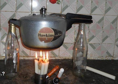 New Age Cooking Appliance with Hawkins cooker on it (Candle Stove)