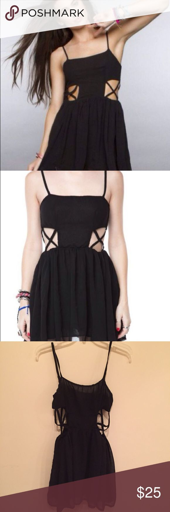 """Rare Cut Out Pauline Dress By Brandy Melville ❤️ Ready to Party? 'Tis the Season ✨ Hipster black mini dress with seductive criss cross side cut outs and adjustable Spaghetti straps✨ Size: Label reads """"One size fits all"""" will fit size XS/S; Material: 65% Cotton, 35% Polyester ❤️ Brandy Melville Dresses Mini"""