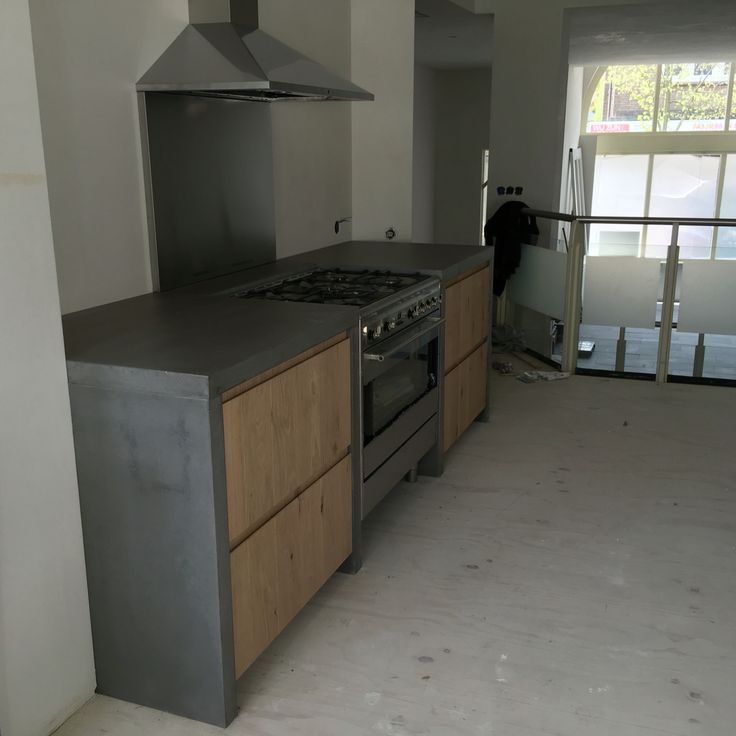 Betonnen werkbladen en massief eiken keuken