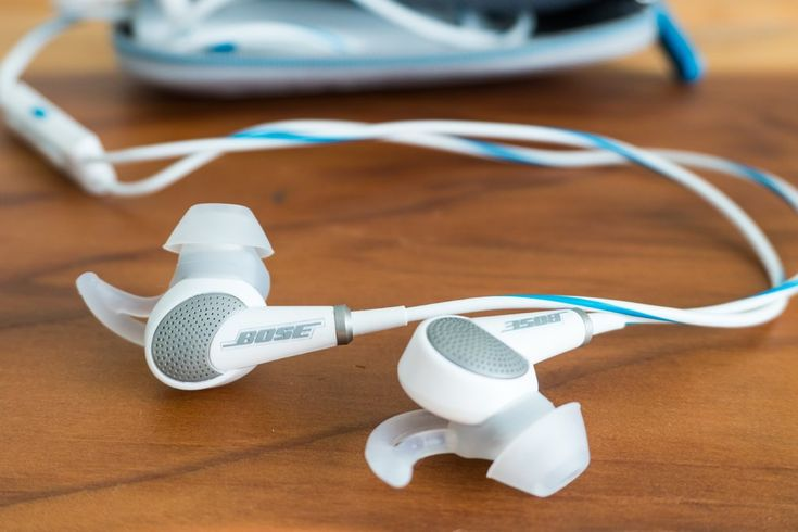 The Bose QuietComfort 20 noise cancelling earbuds reduce ambient noise by a noticeable and welcome amount to make air and train rides quite a bit more relaxing. We've travelled around the world with these and wouldn't leave home without them.