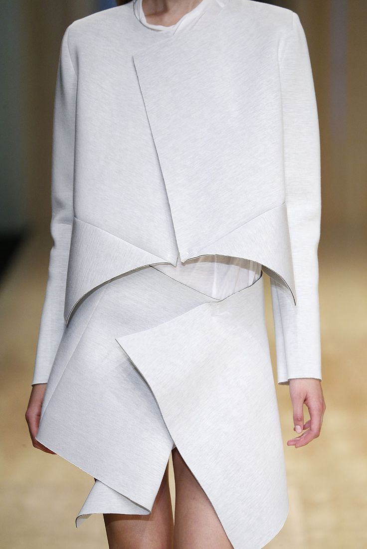 White geometric and deconstructed cut outfit by Txell Miras 'Present' Collection SS15 at 080 Barcelona Fashion Week. Catalonia.