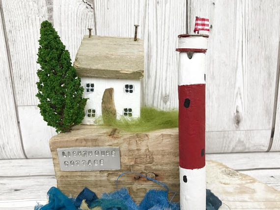 Gorgeous Lighthouse sculpture/ ornament that would make an ideal 5th wedding anniversary, present, new home gift or a unique addition to a nautical home, seaside or beach themed room, or how about the bathroom?! This lovely, handcrafted sculpture has been made using driftwood and other