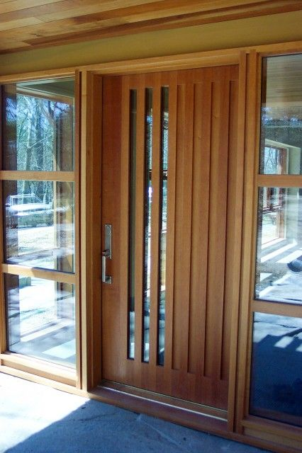 Modern front door with vertical detail.