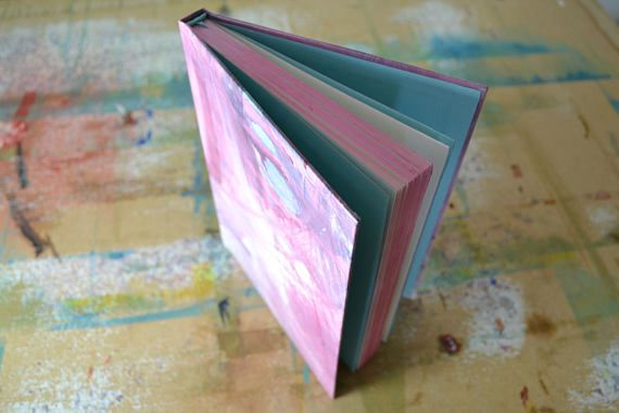If you are looking for a journal thats a little bit different, look no further! This beautiful book holds 100 pages of thick, white, unlined 140gsm cartridge paper, suitable for all media. This book is complete with unique hand-painted cover, pink ombré page edges and ribbon page marker. Whether you want to jot down ideas, write a novel or sketch your surroundings, this, hand-painted, handcrafted journal is completely unique, just like you
