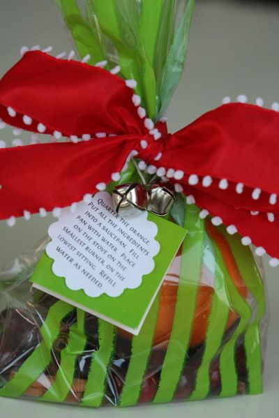 """friend and neighbor gifts for our open house - one orange, 1/2 c cranberries, 1 Tbs whole cloves, 3 sticks cinnamon, a bit of grated nutmeg. Instructions: """"Quarter the orange, place all in a small saucepan filled with water and simmer on lowest setting. Refill water as needed."""