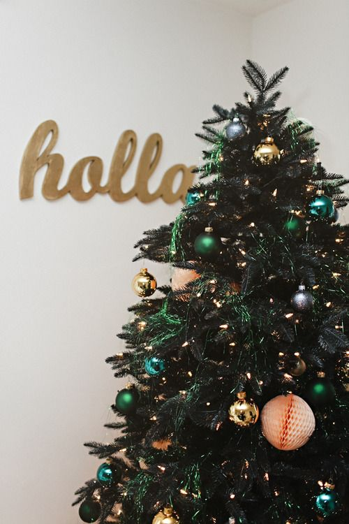 In love with this tree.  The green tinsel, peach and gold.  The Glitter Guide