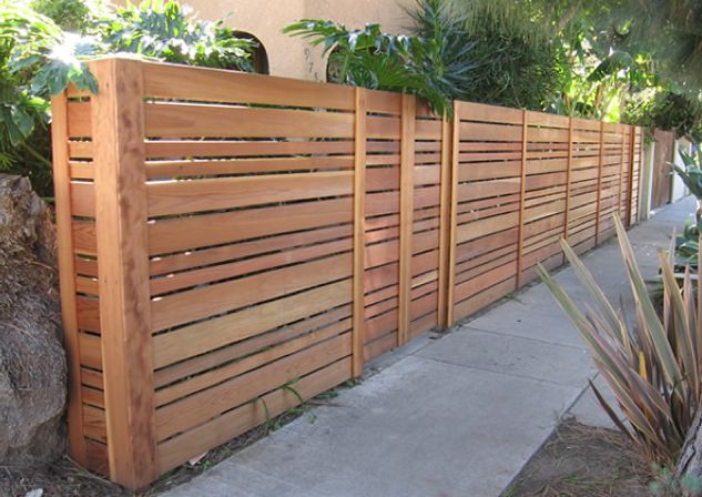 Custom Hardwood Fence by Highside Fencing.