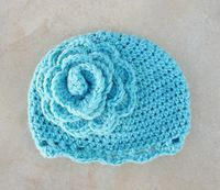 Crocheted Children's Cloche With Giant Flower - creative jewish mom - links to patterns