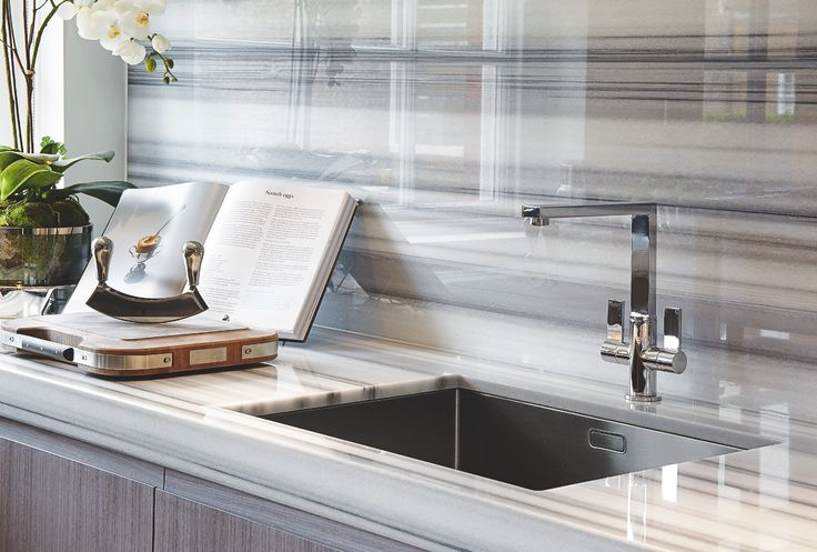 Continuing a striking glossy marble onto the splashback creates a cohesive finish in this kitchen by Katharine Pooley. The Zebrino marble worktops cost £950sq m, including supply and fitting.
