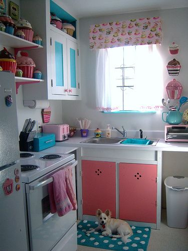 i love cupcakes. so cute. wouldn't want the whole decor, but maybe one cute pop of color on a shelf in the kitchen?