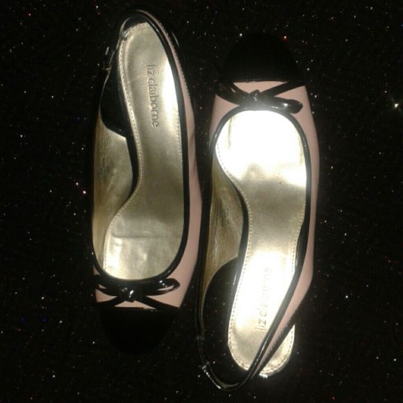 Liz Claiborne pink bow heels Dainty, pink Liz Claibornes with black bows and a cute little heel. Leather upper. Very little signs of wear except on bottoms as shown in pictures above. Liz Claiborne Shoes Heels