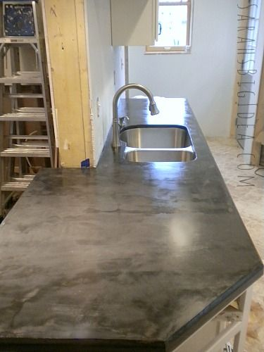 DIY faux-crete countertops. Concrete troweled over plywood and sealed.