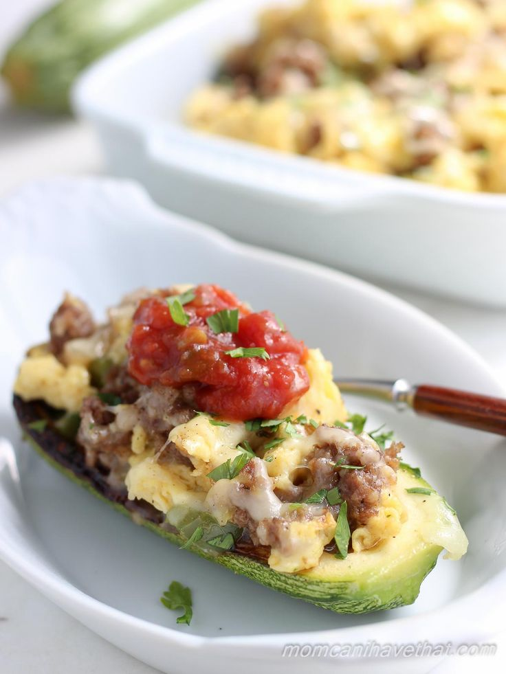 Zucchini Breakfast Boats filled with sausage, scrambled eggs and pepper jack cheese. | low carb, gluten-free, keto, thm | lowcarbmaven.com