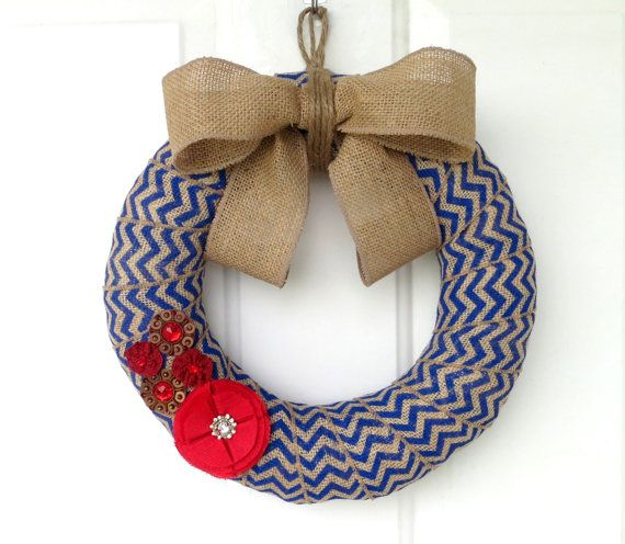 This 12-inch burlap wreath is created on a straw form and wrapped with wired edge burlap. The burlap has a blue chevron design on it. The