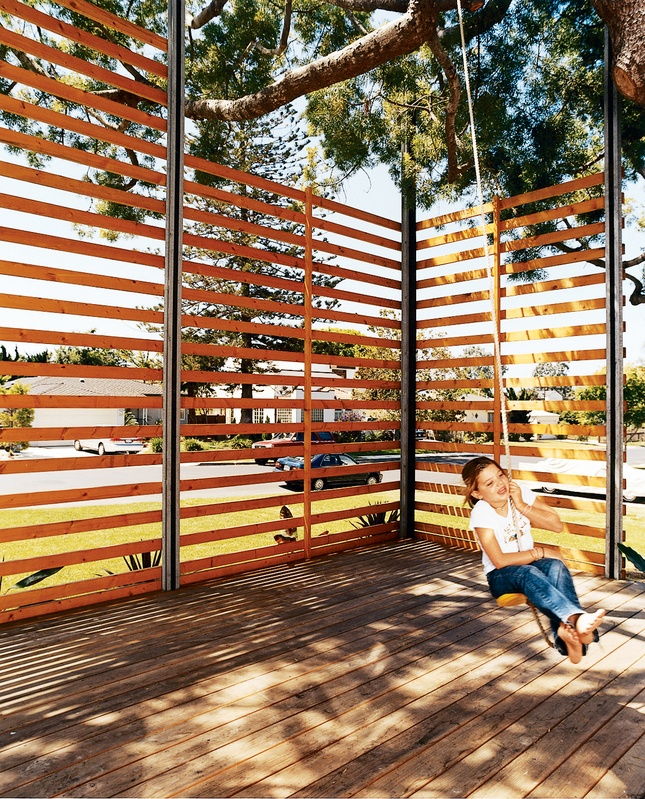 Custom built steel-frame wood screen shaded by a wonderful tree. via dwell