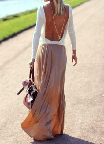 plunging back + maxi skirt + draped chain