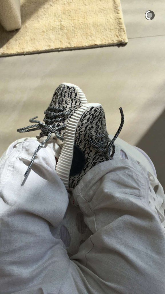 Meanwhile, Saint West showed off his baby Yeezys.