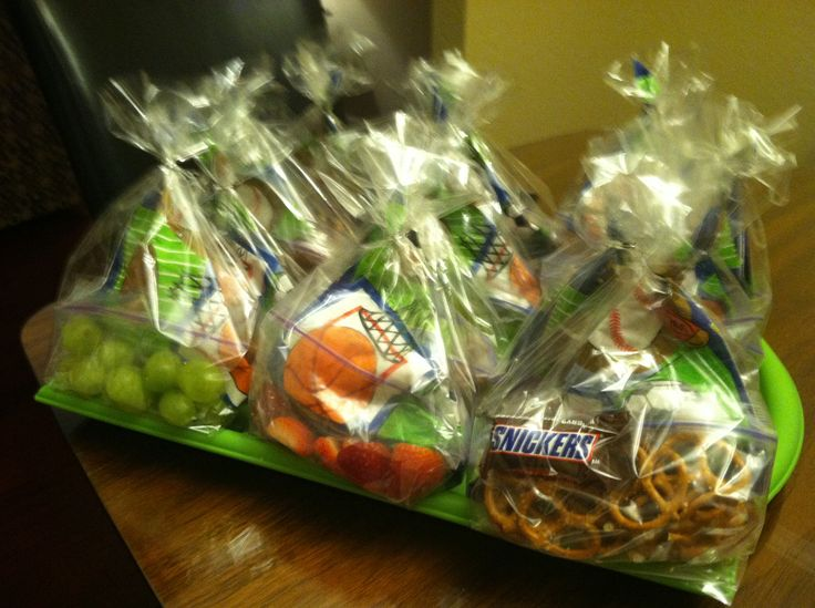T-ball snack treats: fruit, pretzels & mini Snickers bar w/baseball themed napkin in a  clear treat bag