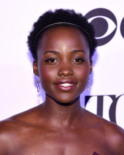 Do as Lupita does and dress up short natural hair with a princess style hair band.