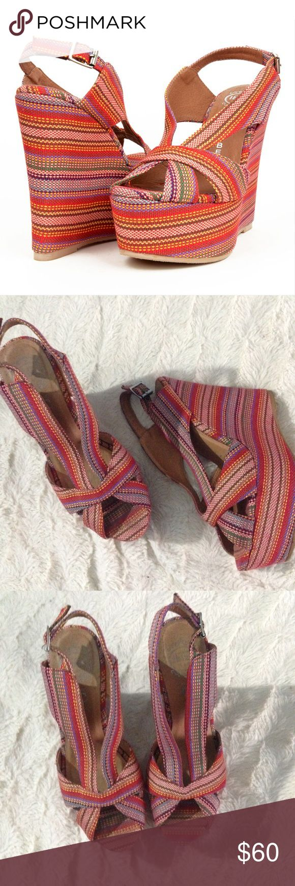 "Jeffrey Campbell Mariel Red Aztec Stripe Wedges Take a trip over the rainbow, and grab a pair of Jeffrey Campbell Mariel Red Aztec Stripe Wedges while you're there! Shades of red mingle with all the colors of the rainbow in a vibrant weave of stitched stripes, for a sandal that is a dream come true! Open toe upper has the cutest strappy shape, with a delightful silver-buckled slingback. 1.75"" woven toe platform gives the 5"" wedge heel (plus rubber tip) something to build on. Cushioned…"