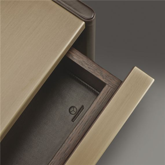 Brass top and drawer front, dark stained timber, leather