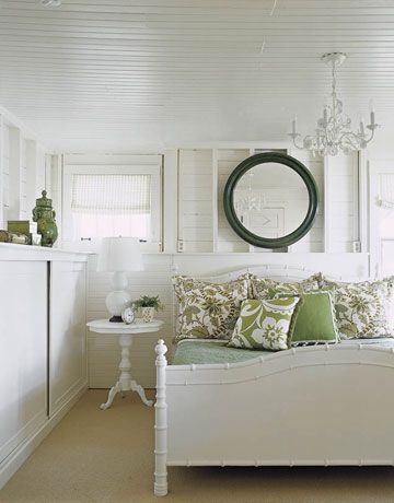 White Bedroom with a Touch of Green Designer Tom Stringer hung an