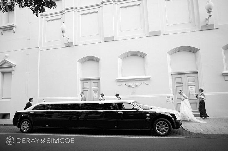Modern wedding car: a black limousine  Location ~ King Street, Perth  Photography by DeRay & Simcoe