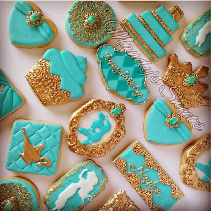 Princess Jasmine inspired cookies for Haylee's 15th birthday ✨ #princessjasmine #genielamp #cupcake #jasminesilhouette #crown #cake #cookies #princessjasminecookies #gold #teal  FRAME COOKIE CUTTER FROM @trulymadplastics DIAMOND STENCIL FROM @hillaryramos