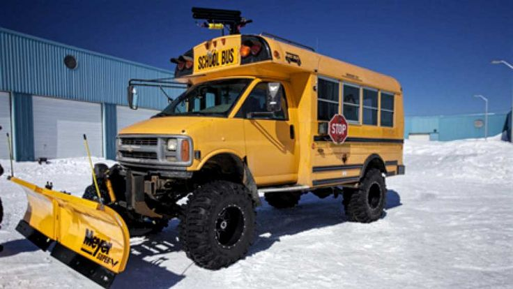School Bus Snow Plow - Driving in snow is no problem for this short bus snowplow conversion.