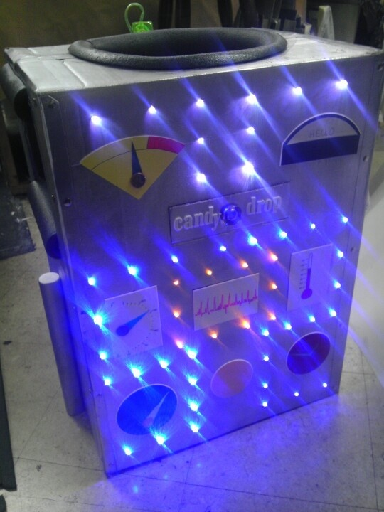 Close-up of DIY robot costume; good template for making your own. Use these little LED lights, perrrrfect + totally inexpensive: http://www.flashingblinkylights.com/blinkiesroundleds-c-114_61_1.html
