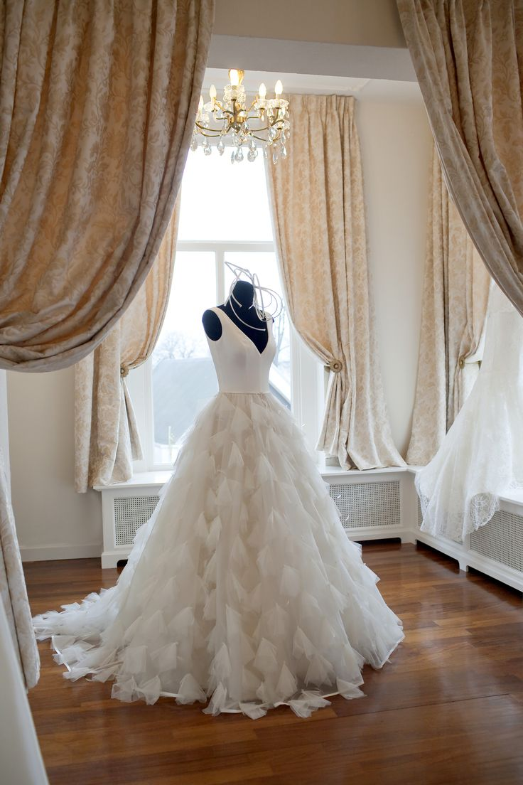 Wedding gown made of silk satin and hand draped silk tulle skirt