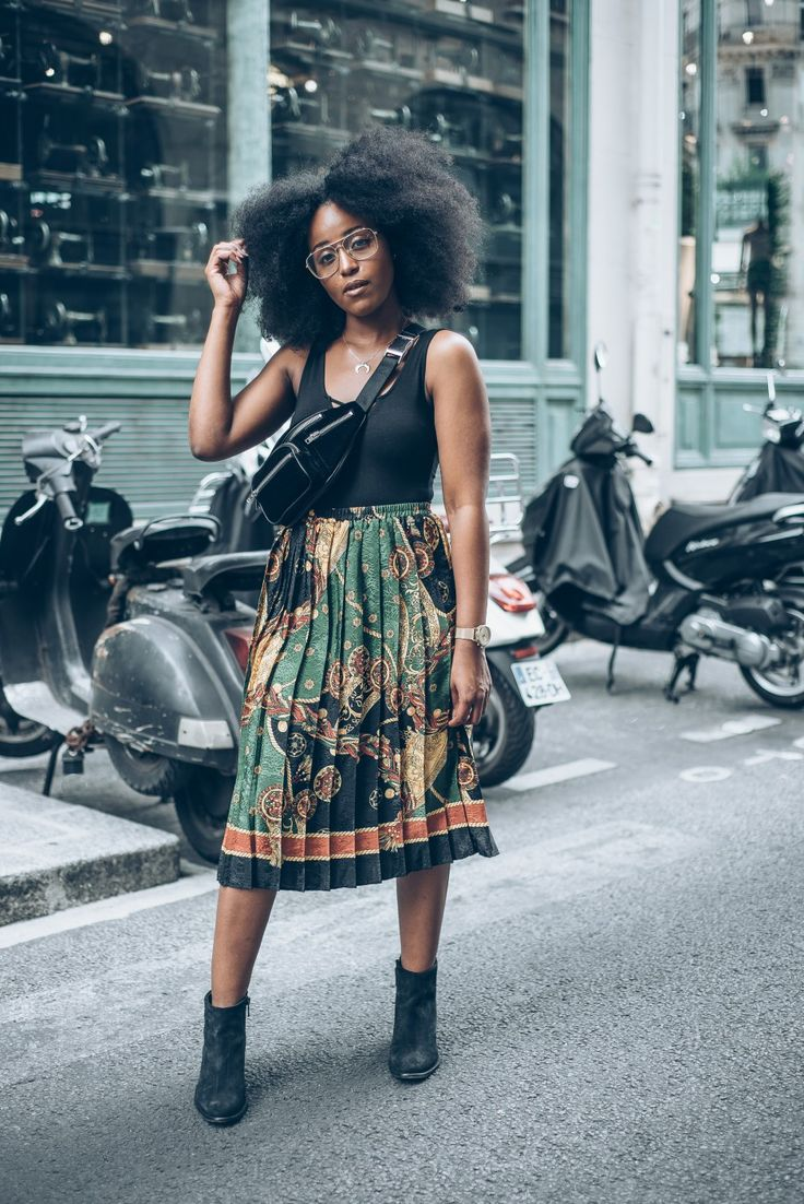 musesuniform-diesel-boots || afro hair. kinky hair. natural hair. frizzy hair. pleated skirt and bots. pretty hair.