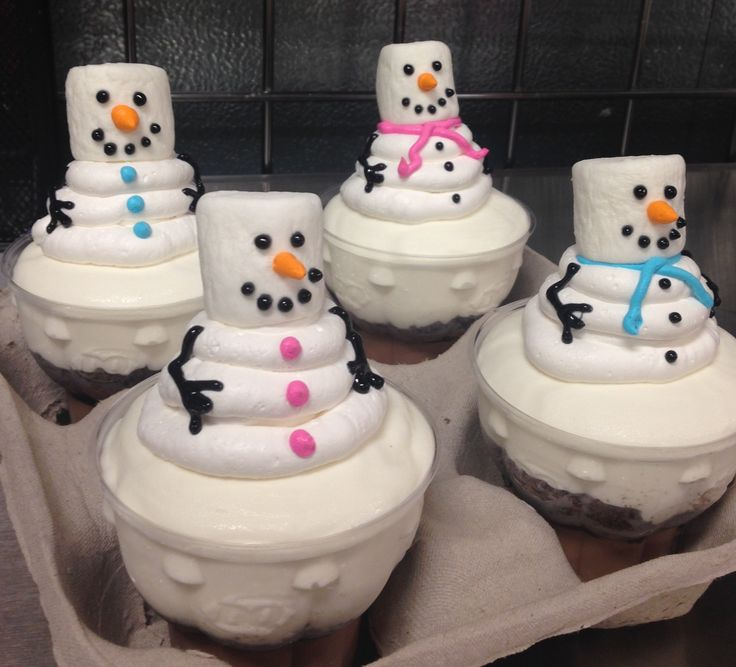 Snowmen DQ ice cream cupcakes with whipped icing and marshmallow heads.