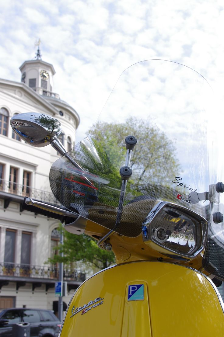 Feeling happy when cruising on the Yellow Vespa Sprint