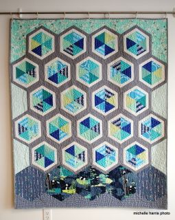 """52"""" x 62"""" this is a lovely throw quilt appropriate for adults and children alike.  It is composed of pieced, framed hexagons with custom quilting .  the bottom row of hexagons have panda bears featured on the fabrics.  The backing is a mottled greyish-taupe fabric.    The quilt has been laundered so that it is very crinkly and all the shrinkage has already happened."""
