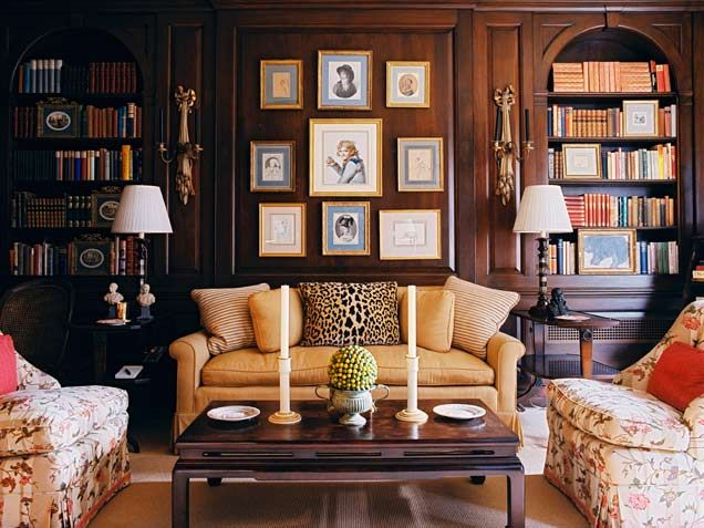 Absolutely LOVE the dark wood paneling. This feels like an old English/European manor house. Would love a library like this.
