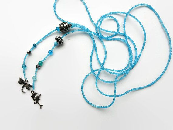 Long lariat seed bead necklace turquoise, long  necklace,  seed beads, blue glass beads, Bali beads. 2 charms: a dragonfly and 2 dolphins.