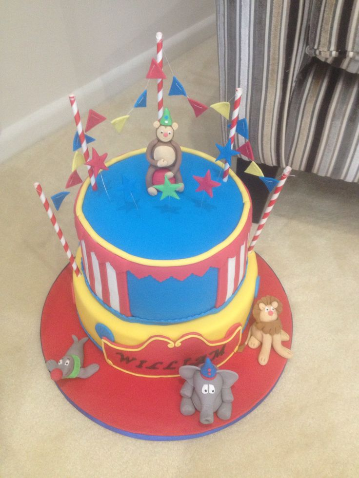 Circus themed two tier Sugar craft figures and buntin