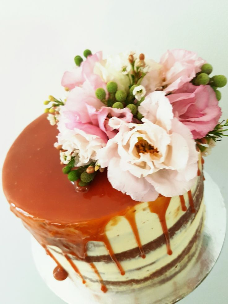 Naked cake with salted caramel and fresh flowers