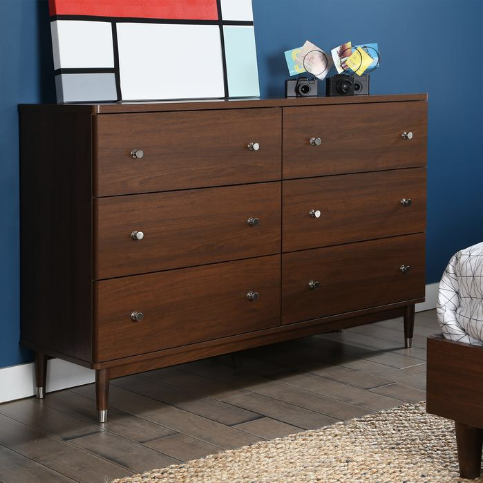 Features:  -Stylized metal knobs with a brushed nickel finish.  -Wooden legs on metal caps.  -Rounded corners and drawer fronts accentuate the 70s style.  Frame Material: -Manufactured wood.  Product