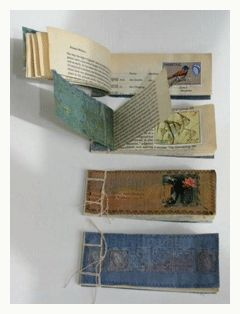 great presentation of 4 handmade sketchbooks showing the interior and the exterior, using multiple versions of similar/the same workbook in one image might help show a story/journey in a photograph better than one?