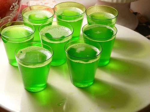 Ingredients   1 cup vodka, chilled   1 package green apple jell-o   1 cup boiling water   20 dixie cups       Directions   Mix the boiling water with a package of green apple jell-o. Allow the jell-o to dissolve for 1 minute.   Stir in vodka and pour into cups. Refrigerate until jell-o sets.