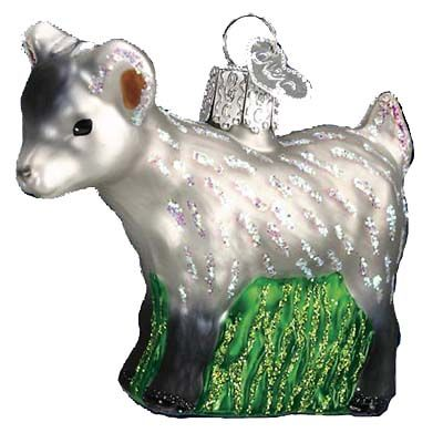 """Pygmy Goat **Introduced 2009** 12285, Merck Family's Old World Christmas Ornament measures approximately 2 1/4"""", made of mouth blown, hand painted glass. Pygmy Goats originated"""
