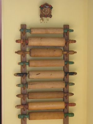 Vintage rolling pins displayed on a simple rack.  Vintage Values: Home Collections.