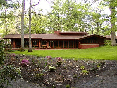 Frank Lloyd Wright's plans specified solid plate glass along the rear facade. Mrs. Zimmerman, however, insisted on ventilation. Wright's plans were modified to include casement windows facing the gardens.    The boundaries between indoors and out vanish when French doors in the dining area fold open. Throughout the house, window corners are mitered to form an uninterrupted band of open views.